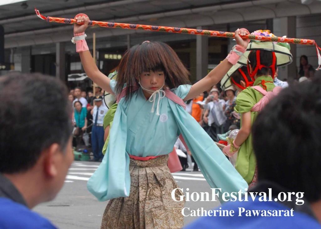 shijo kasa boko boy stick dancer gion festival kyoto japan