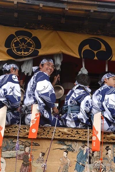 niwatori boko bell musicians smiling closeup gion festival procession kyoto japan
