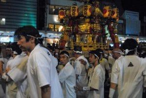 Show men carrying the mikoshi portable-shrines during the Gion Festival shinkōsai
