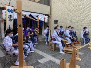 Festival musicians play music while wearing masks during covid.
